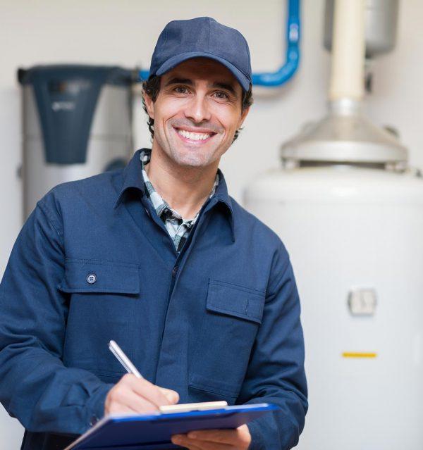 technician-servicing-hot-water-heater
